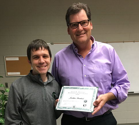 Photo of Jonathan Rennheck recieving the 2016 Hoffert award.